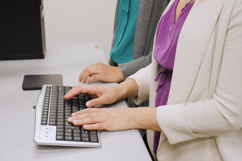 Lady typing on a keyboard
