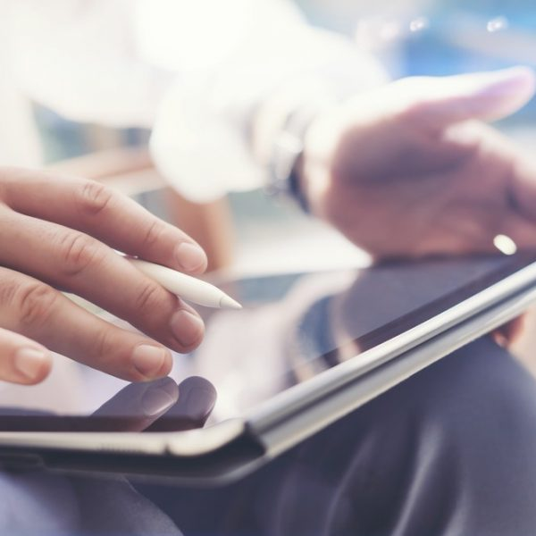 Person using tablet with stylus