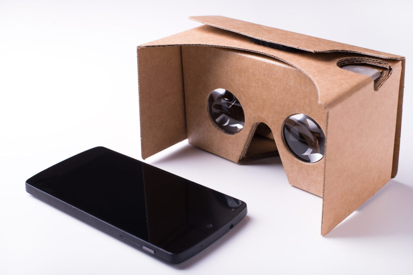 A woman using Google Cardboard