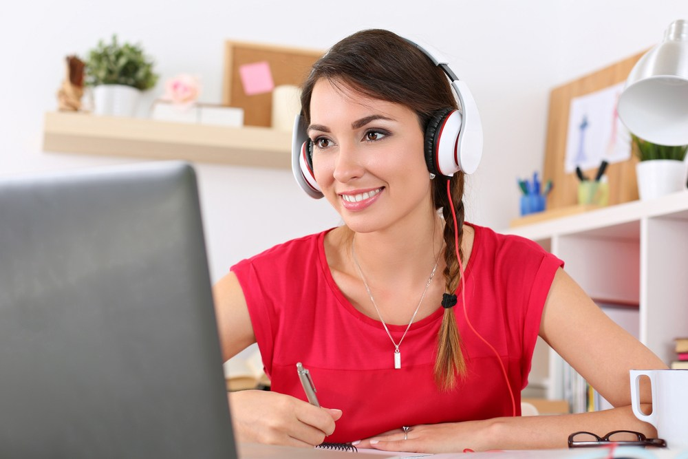 Woman with headphones at computer