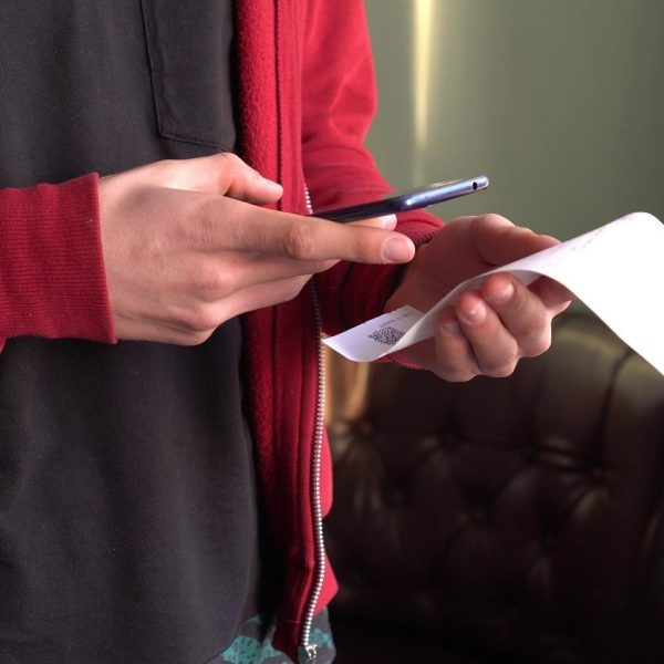 man scanning a receipt with a smartphone
