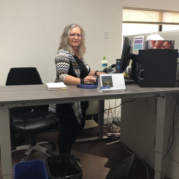 Gail at her sit-stand desk